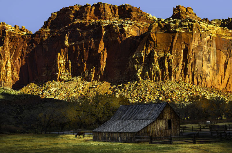 Capitol Reef National Park is a hidden wonder of beauty few people travel to visit. No People Capitol Reef National Park National Parks Adventure Travel Travel Photography Nature Nature Photography Outdoors Outdoor Photography Landscape Landscape Photography Rocks Clouds Colors Desert Sky Scenic View Scenery Trees Landmark Fruita Barn Rock Formation Architecture