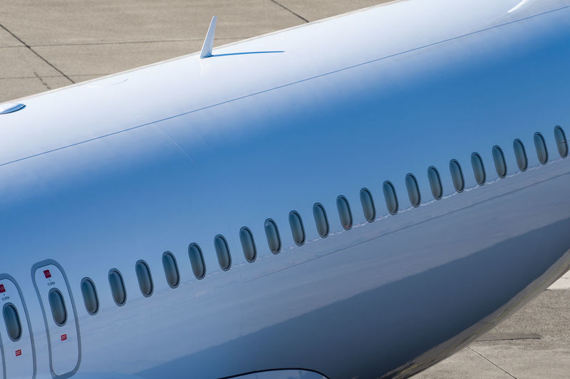 Airport Travel Traveling Business Finance And Industry Public Transportation Public Transport Plane Aerospace Industry Aeroplane Ramp Jet No People Metal White Color Transportation Close-up Blue Air Vehicle Airplane Day Pattern Mode Of Transportation Indoors  Nature High Angle View Technology Shape Design