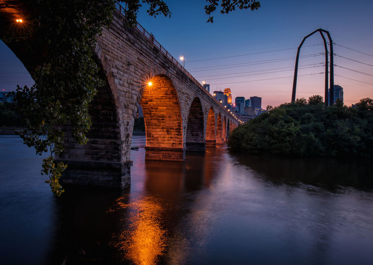 Minneapolis Architecture Bridge - Man Made Structure Building Exterior Built Structure City Connection Day Illuminated Nature No People Outdoors Reflection River Sky Sunset Tree Water Waterfront