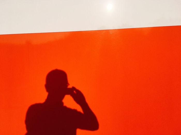 Technology One Person Real People Lifestyles Red Wall - Building Feature Leisure Activity Photographing Orange Color Men Silhouette