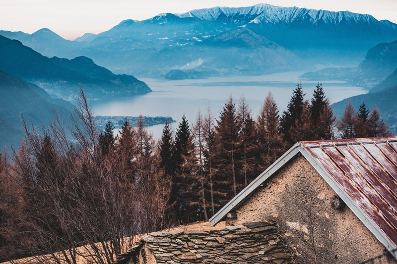 High Angle View Of Houses And Mountains During Winter
