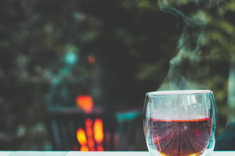 Smoke - Physical Structure Refreshment Drinking Glass Wineglass Wine Heat - Temperature Drink Burning Focus On Foreground No People Food And Drink Day Flame Outdoors Alcohol Steam Close-up Defocused Water Nature Sommergefühle Wine Not Capture Tomorrow