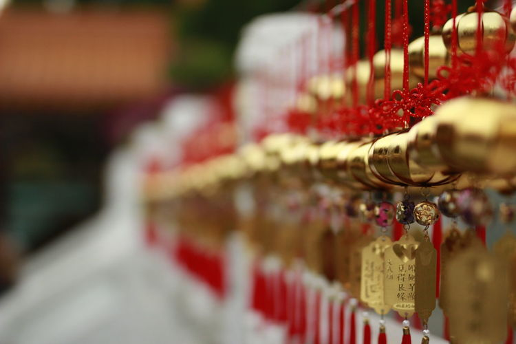 Goldren Bell at Wenwu Temple Selective Focus Religion Belief Spirituality In A Row Place Of Worship Large Group Of Objects Red Close-up Celebration Architecture Candle Order Built Structure Event Praying Luxury Bell Temple Backgrounds