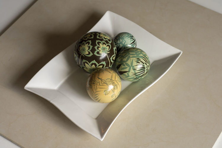 Decoration ball Indoors  No People High Angle View Still Life Close-up Art And Craft Pattern Table Paper Creativity Container Decoration Design Directly Above Egg Plate Animal Food Wealth Luxury