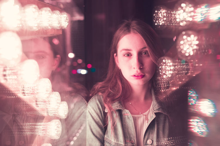 Portrait of woman with illuminated lights