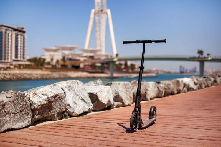 Dubai, uae, april 2019 electric scooter on the background of the island of blue waters in dubai