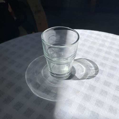 High angle view of water in glass on table