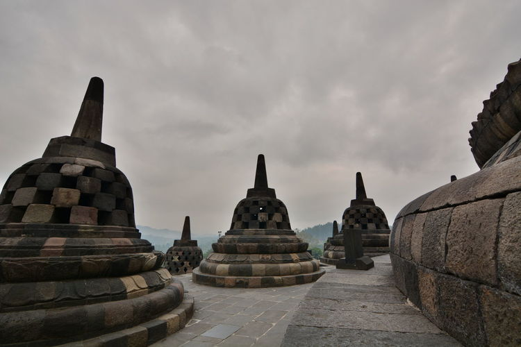 Stupas in Borobudur temple. Yogyakarta. Java. Indonesia Outdoors Stone Material No People Ancient Travel Destinations Ancient Civilization The Past History Built Structure Spirituality Architecture Place Of Worship Religion Belief INDONESIA Java Javanese Culture Yogyakarta Yogyakarta, Indonesia Jogjakarta Southeastasia Southeast Asia Borobudur Borobudur Temple Temple Temple - Building Temple Architecture Stupa Stupas Buddhism Buddhist Temple Tourism