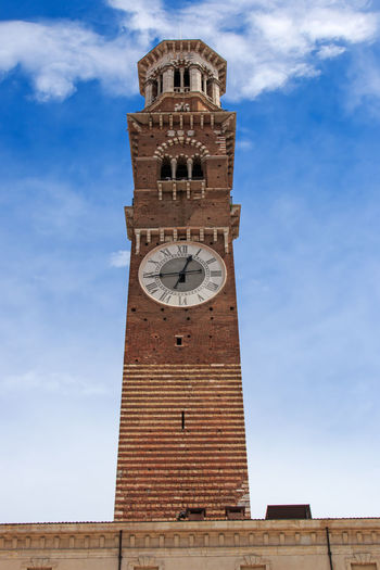 Low angle view of torre dei lamberti against sky
