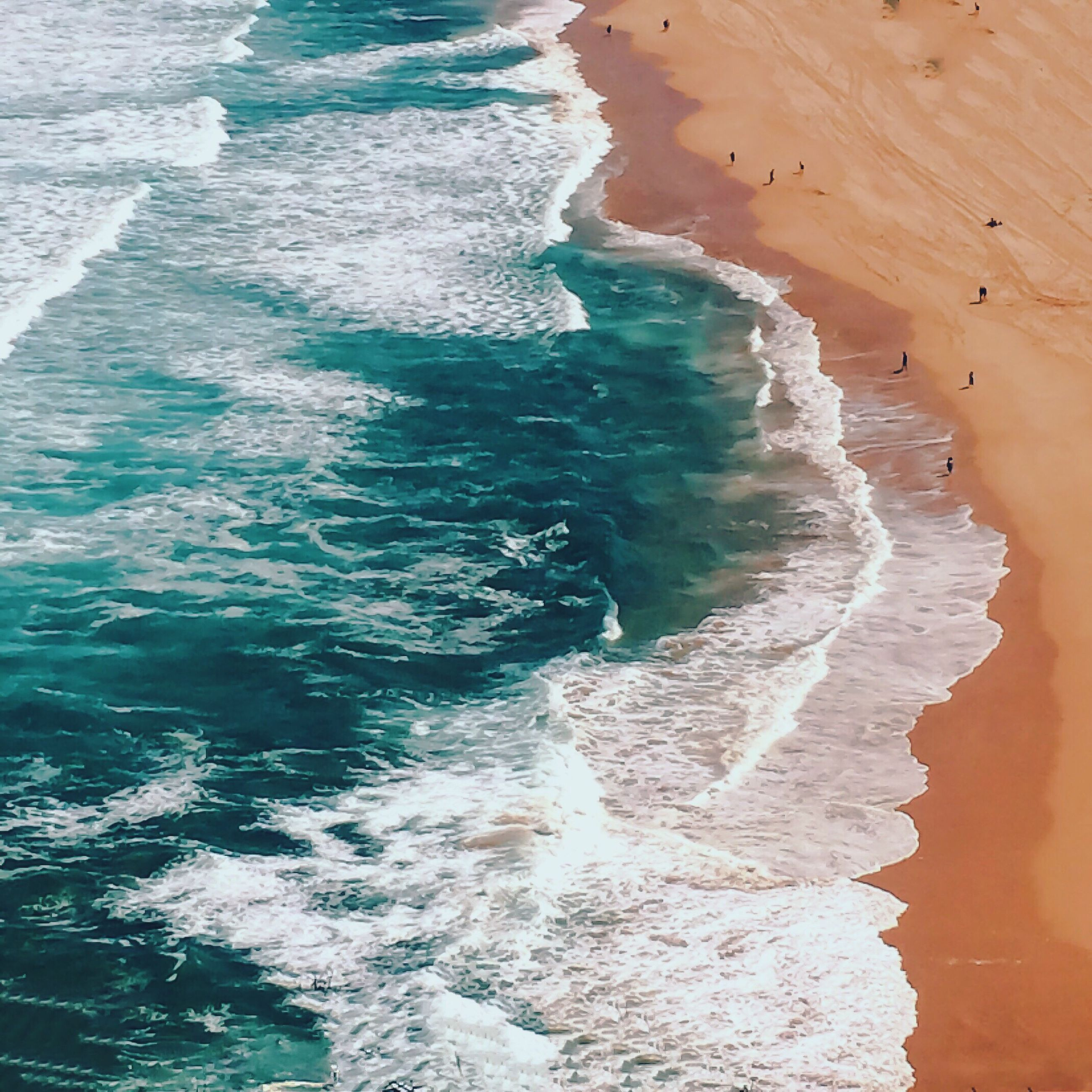 sea, beach, water, wave, surf, shore, beauty in nature, nature, scenics, coastline, sand, tranquil scene, tourism, tranquility, day, non-urban scene, outdoors, remote, cliff, power in nature, vacations, tide, majestic, splashing, no people, ocean