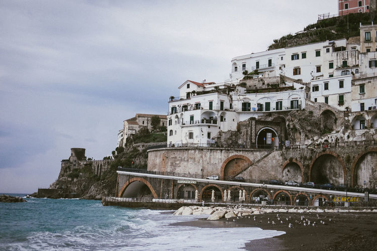 Atrani by day Built Structure Architecture Water Building Exterior Sky Nature Travel Destinations Arch Building Waterfront No People Outdoors Italy Amalfi Coast Sea Beach Southern Italy