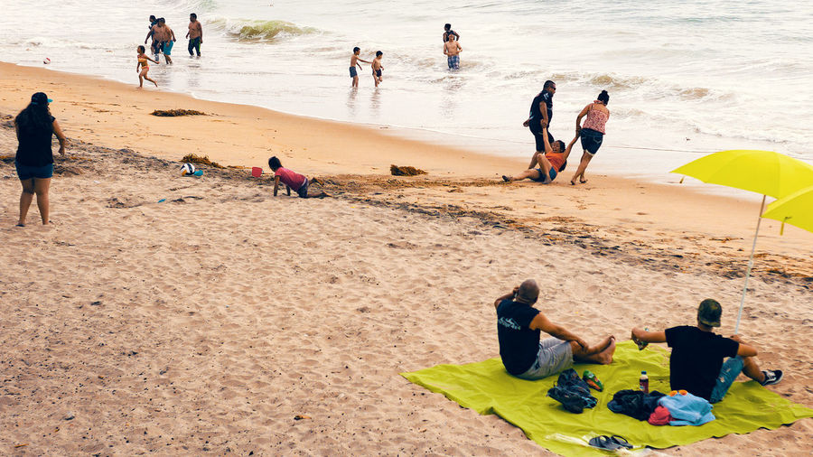 Beach Day Enjoying Enjoyment Group Of People Large Group Of People Leisure Activity Lifestyles Medium Group Of People Men Mixed Age Range Nature Person Relaxation Sand Sea Shore Sitting Summer Sunlight Togetherness Tourism Tourist Vacations Showcase July