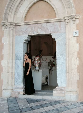 People And Places Lady In Black Sicilian Girl Arch Building Exterior Architecture Waiting ... People Of EyeEm Beautiful Girl Black Dress Standing Alone