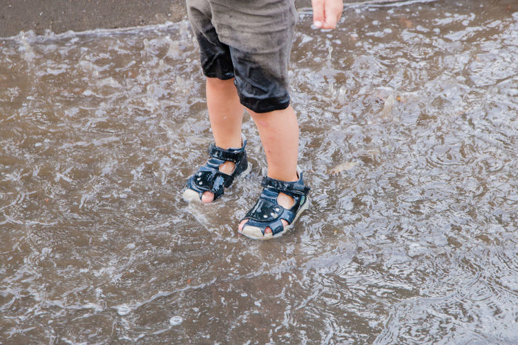 children's legs in a puddle Body Part Boys Child Childhood Day High Angle View Human Body Part Human Foot Human Leg Human Limb Leisure Activity Lifestyles Low Section Men Motion Nature Offspring One Person Outdoors Shoe Shorts Standing EyeEmNewHere