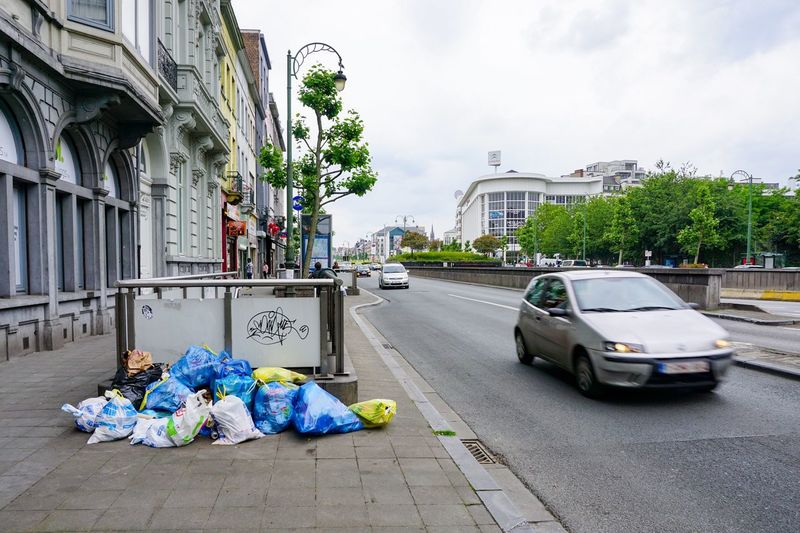 Garbage on street in city