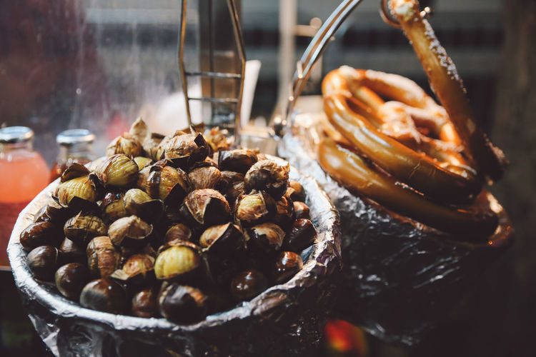 High Angle View Of Pretzels And Chestnuts For Sale In Shop
