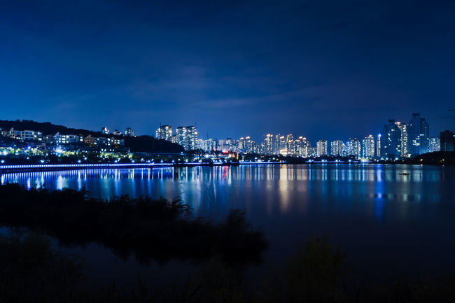 DOREMIIMAGES Architecture City Cityscape Construction Firelight Night Light Night Lights Reflection Skyline Architecture Blue Building City Lake Lake View Night Night View No People Outdoors Park River Sky Tectonics Urban Water