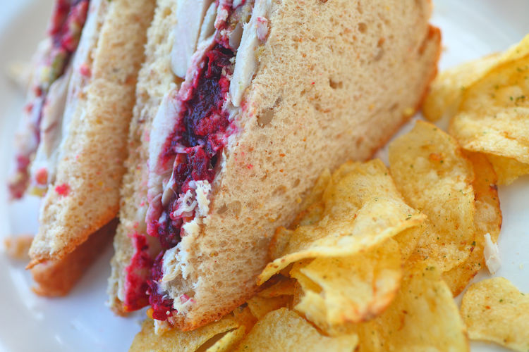 Turkey sandwich with potato chips Food Ready-to-eat Freshness Close-up Bread No People Meal Turkey Sandwich Thanksgiving Leftovers Sandwich Cranberry Sauce  Potato Chips Lunch Textures Natural Light Snack Homemade Food Whole Grain Bread Delicious Poultry Healthy Eating Crisps