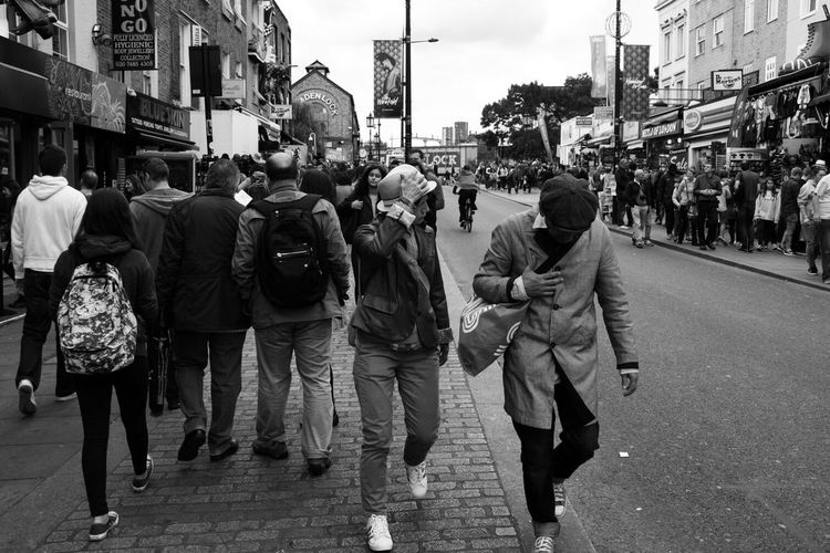 Panoramic view of people walking in city