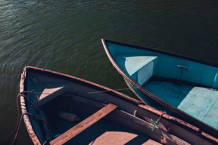 High angle view of fishing boat moored in lake