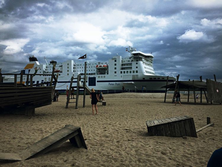 Peter Pan Kreuzfahrtschiff Travemünde Sky Built Structure Cloud - Sky Architecture Beach Building Exterior Sand Real People Day Sea Men Outdoors Lifestyles Full Length One Person Nature City People
