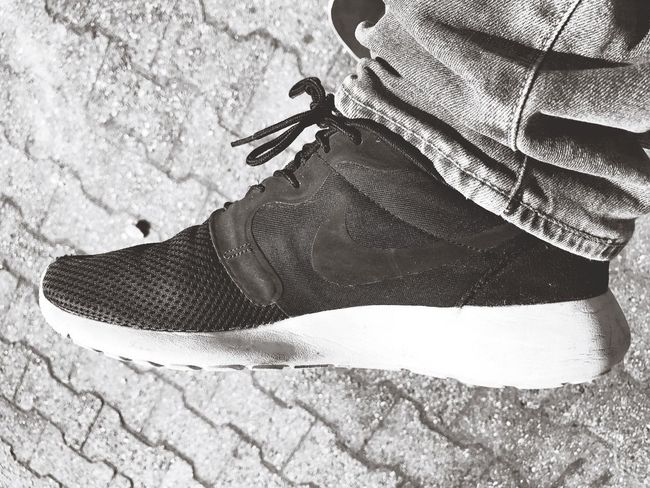 I like Nike... Standing Shoes First Eyeem Photo Blackandwhite Black And White Photography Real People Lifestyles One Person Outdoors Day Close-up Black And White Blackandwhite Photography IPhoneography Iphone7 Nike Low Section People Marteria Welcome To Black