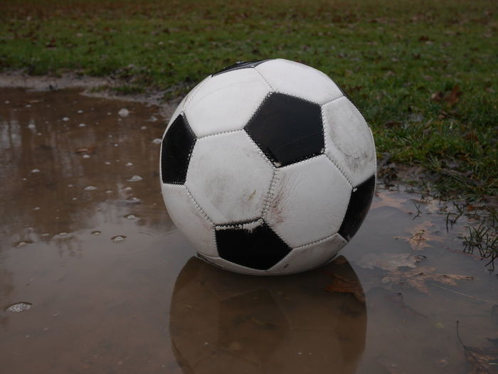 Close-up of soccer ball on footpath