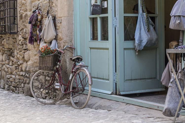 an old bike in Peratallada Catalunya EyeEmNewHere Old-fashioned Bici Da Corsa Bici, Bicycle Bike Bikesaroundtheworld Old Storm Cloud Vintage