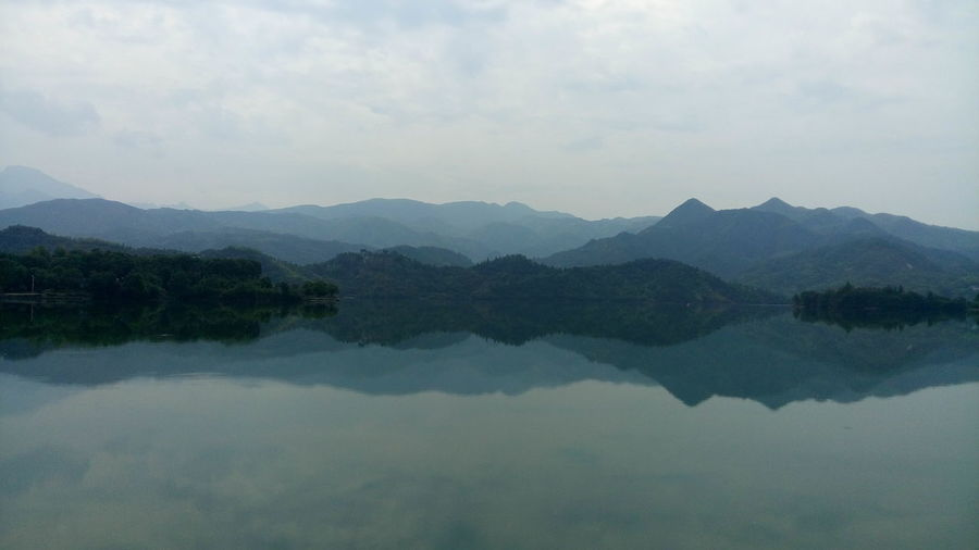 Reflection Water Lake Mountain Tranquil Scene Scenics Tranquility Waterfront Beauty In Nature Calm Nature Majestic Sky Mountain Range Non-urban Scene Day Water Surface Cloud - Sky Standing Water No People