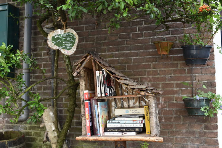 Architecture Book Bookhouse Books Building Exterior Built Structure Day Donation Hanging Library LOVE FOR BOOKS Nature No People Outdoors Plant Potted Plant Reading Take A Book Tree