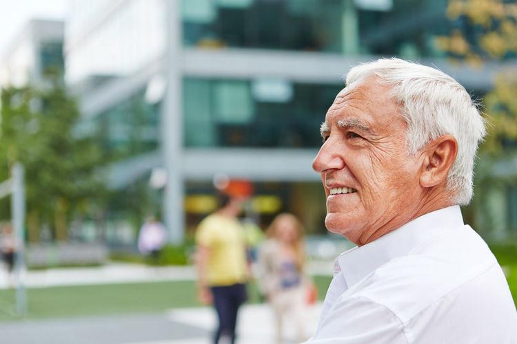 Close-up of senior businessman in city