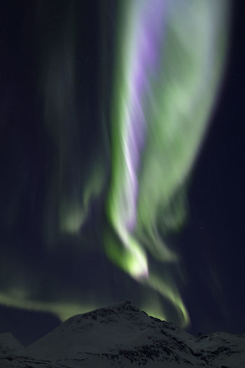 Aurora Borealis Northern Lights Norway Scandinavia Astronomy Beauty In Nature Green Color Landscape Luminosity Mountain Mystery Nature Night No People Outdoors Polarlight Power In Nature Purple Scenics - Nature Sky Space Star - Space Tranquil Scene Tranquility