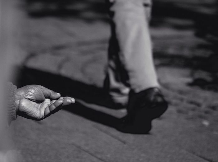 Person ignoring beggar