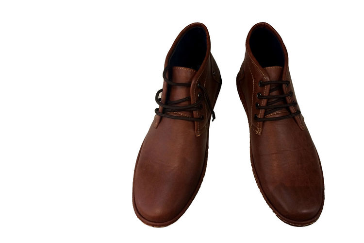 Close-up of brown shoes over white background