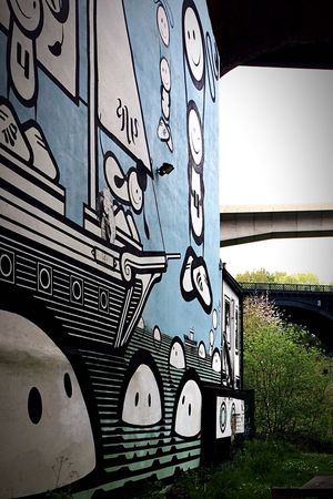 Three Bridges - Ouseburn Graffiti against the Backdrop Scenery of the Byker ByPass , Metro and Railway bridges. Day Daylight Daytime Urban No People