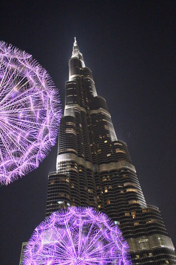 Architecture Building Building Exterior Built Structure Burj Kalifa Celebration City Decoration Illuminated Low Angle View Nature Night No People Office Building Exterior Outdoors Purple Sky Skyscraper Tall - High Tourism Tower Travel Destinations Tree