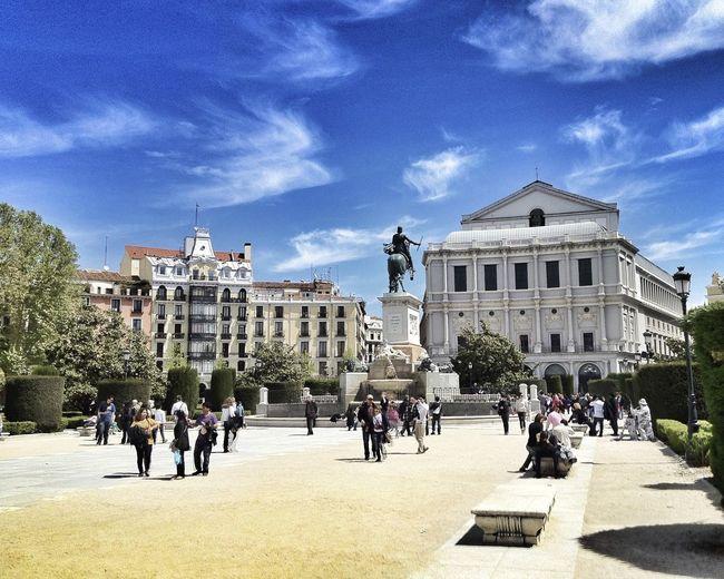 Tourist at museum outside castle square against cirrus sky
