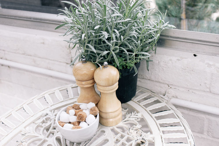 Potted plants by bowl with food on table