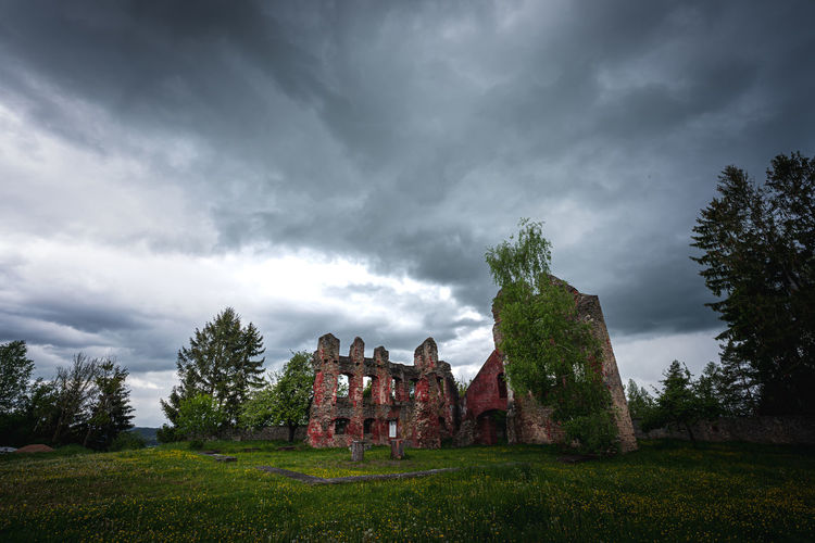 Old ruins of building against cloudy sky