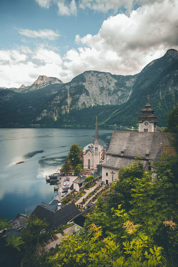 Church at lakeshore against mountains