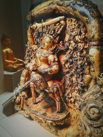 Two Is Better Than One Seventeen Angry Heads with Buddha in the background Central Tibet 15th Century Extreme Close-up Indoors  Close-up Spirituality Sculpture HistoricalObject Smithsonian Institute Historical Artifact Art Gallery Art Statue Human Representation Buddha Historicalart The Secret Spaces