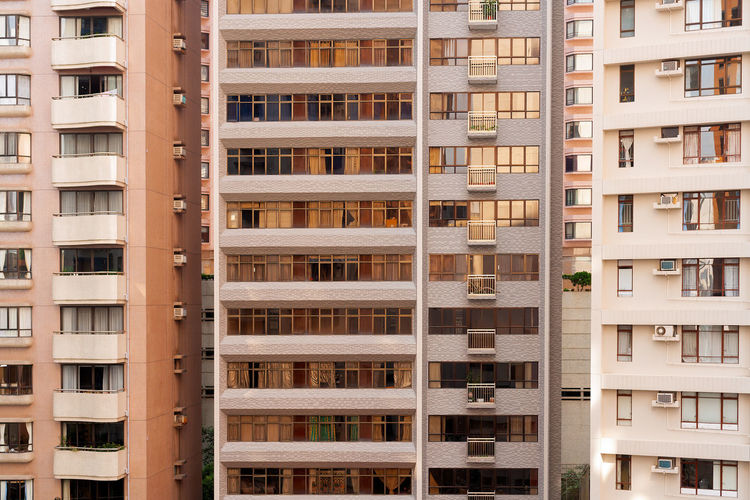 Close-up to a densely populated apartment buildings in hong kong.