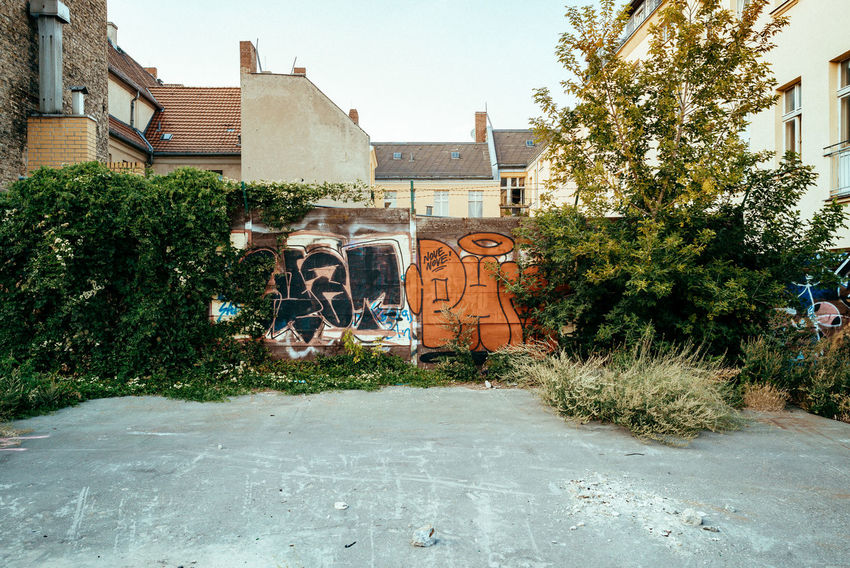 Backyard of Neukölln Backyard Cityscape Urban Geometry Wall Wall Art Architecture Berliner Ansichten Building Building Exterior Built Structure City Day Fence Front Or Back Yard Graffiti Grass Green Color Growth House No People Outdoors Residential District Street Tree Urban