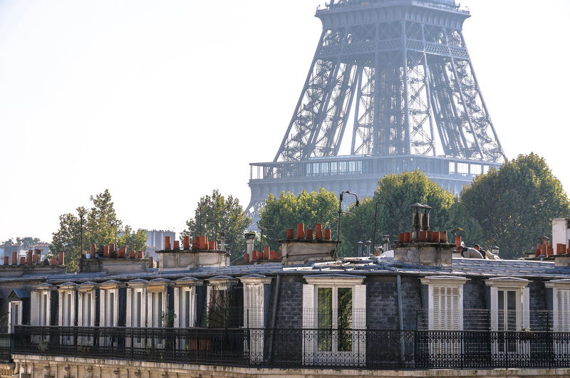 Roofs top of Paris Eiffel Tower Paris Architecture Balconies Building Exterior Built Structure City Day No People Outdoors Sky Tower Travel Travel Destinations Tree Windows Summer In The City