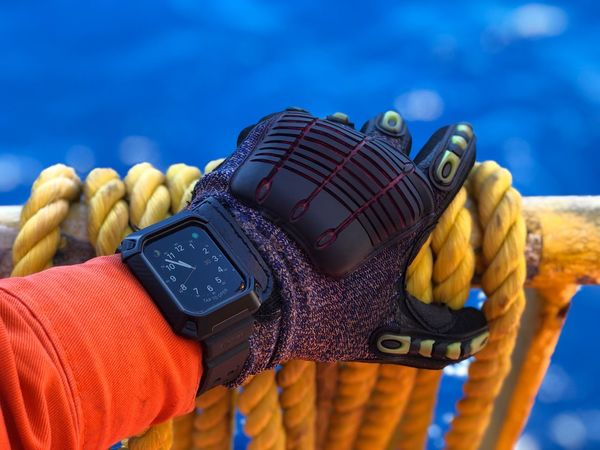 Apple Watch 4 on hard environment - Offshore Oil and Gas Bracelet Supcase Band Apple Watch Apple Inc. Hard Work Ocean Working Orange Clothes PPE Protective Case Protective Workwear Supcase Impact Gloves On Hand Glove Oil And Gas Offshore Apple Watch 4 Watch Close-up Blue Focus On Foreground Rope Yellow Day Outdoors Water Sunlight Personal Accessory Strength
