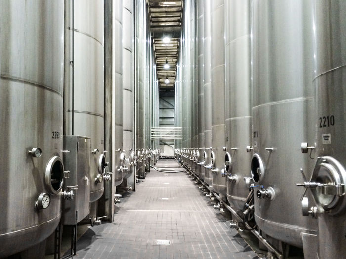 Corridor Amidst Machineries At Bottling Plant
