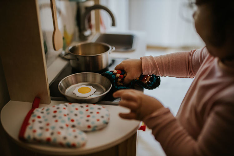 Midsection of woman preparing food at table