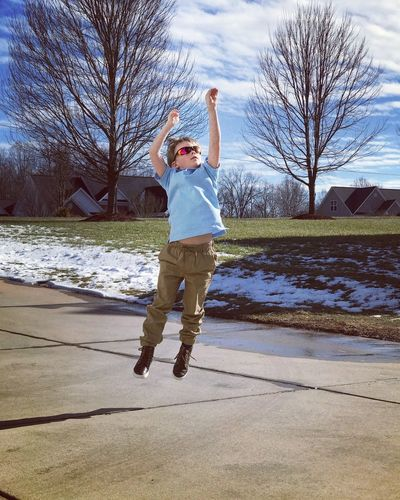 Catching some air... Boy Wearing Sunglasses Snow Covered Melted Snow Blue Sky Beautiful Sky Being Active Outside Activities Sports Boy Playing Basketball Jumpshot Jumping Outdoors Playing Basketball Catching Air Full Length One Person Leisure Activity Tree Outdoors Jumping Day Bare Tree Sport Motion People Happiness