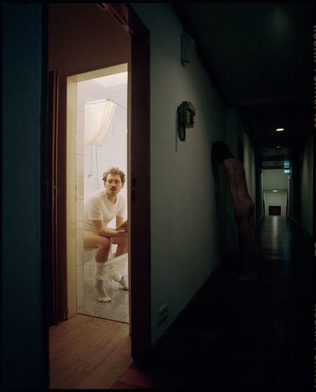 Man standing at entrance of home
