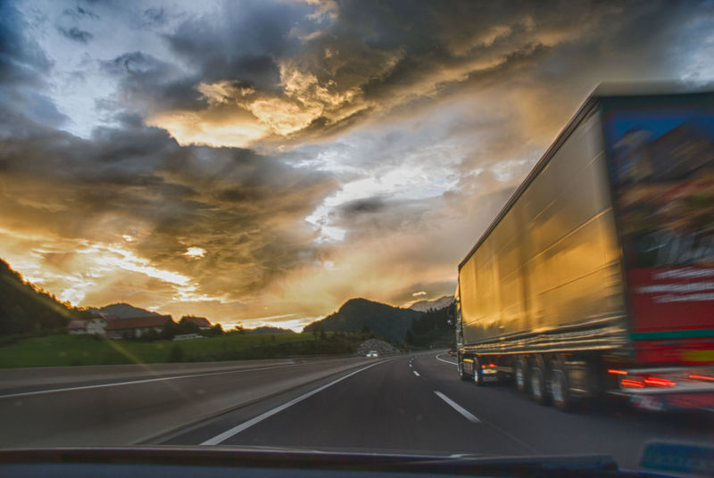 On the road Cloud Cloud - Sky Cloudscape Cloudy Diminishing Perspective Dramatic Sky Illuminated Land Vehicle Mode Of Transport Nature No People On The Move On The Road On The Way Orange Color Outdoors Overcast Road Road Marking Sky Sunset The Way Forward Transportation Traveling Windshield An Eye For Travel Business Stories Mobility In Mega Cities